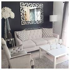 gray living room ideas. dark gray accent wall with white decor. light couch and printed throw pillow! living room ideas