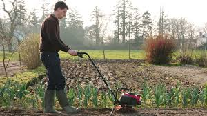 honda microtillers being used by model on location
