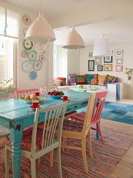 rustic shabby chic table with multi coloured chairs that remind me of monica s in f r i e n d s