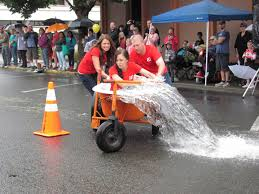 no one ever said being a part of the annual camas days bathtub races was easy the team pictured here spilled more than a little frigid water while