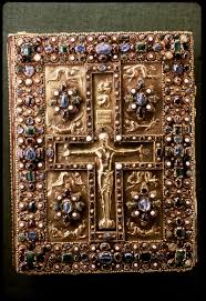 front cover early meval trere bindings with a structure in precious metal and often containing gems carved ivory panels or metal reliefs