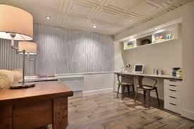 Elegant underground dark wood floor and beige floor basement photo in  Montreal with blue walls