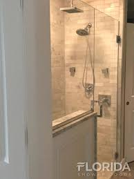 frameless glass shower door with chrome hardware and custom square pull handle
