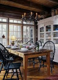 windsor chairs painted black surround the antique dining table susan rogers insistence that nature take priority resulted in an interior perfectly