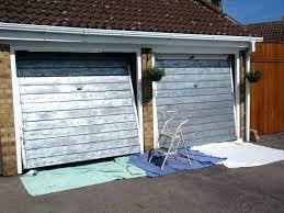 painting steel garage door how to paint a metal garage door with a roller about remodel how to paint a carport garage door style with metal paint metal