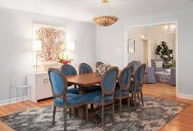 dazzling ikat rug look austin transitional dining room inspiration with blue upholstered dining chairs framed artwork ghost chair gray