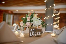 Rustic desert reception with string lights and dining tables. 6 Ways To Enhance Your Rustic Wedding At Our Nashville Wedding Venue