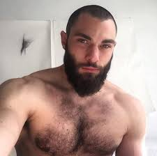Hairy muscular gay man