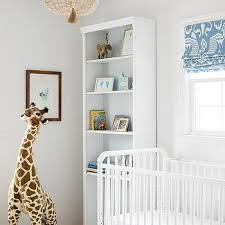 white nursery crib with cream beaded chandelier