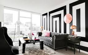 we adore all of the unique details in this room from the black and white patterned walls to the white two faced sculpture on the coffee table