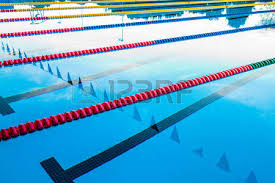 olympic swimming pool background. 50m Olympic Outdoor Pool Corridor Cables Floating And Calm Water Swimming Background