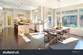 Kitchen And Dining Kitchen And Dining Room Panorama In New Luxury Home Stock Photo