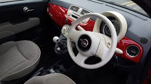 fiat worn white steering wheel red gear lever too