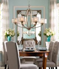 unique high drama and low profile merge effortlessly in this traditional chandeliers for dining rooms