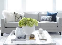 gray linen sofa with glass top coffee table