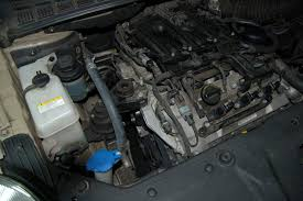 2007 kia sedona hyundai entourage serpentine belt replacement and so here s a photo of the left side of the engine the idiot cover removed see my new belt