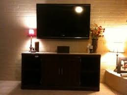 flat screen tv on wall with surround sound. tv installed on brick fireplace san antonio tx flat screen tv wall with surround sound