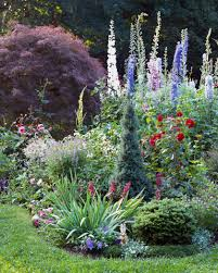 cottage garden with various heights of flowers and greenery