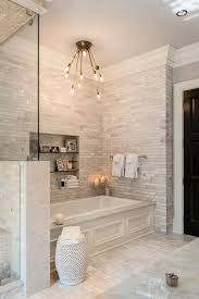 Beautiful, Tiled Bathroom With A Large Soaking Tub And A Shower. However, I  Would Change The Light Fixture Over The Tub.