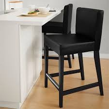 hendriksal brown black counter height chair at a white breakfast bar