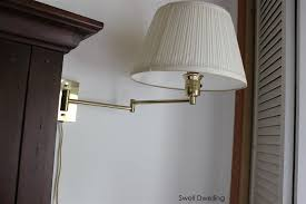i had never really pictured swing arm lamps as a permanent lighting solution in our bedroom but when i saw this lamp from pottery barn i changed my mind