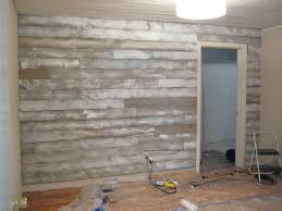 pallet wood wall whitewash. once our accent wall was complete, brian installed trim. he used the same molding as guest bedroom shown here. pallet wood whitewash