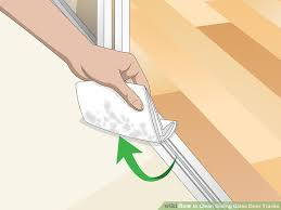 image titled clean sliding glass door tracks step 4