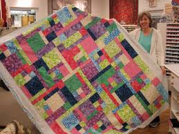 Wilsons, Your Favorite Quilt Shop: Turning Twenty Again! & Kathy whipped this up for her teenage daughter! Awesome colors! A great  fatquarter quilt! The pattern is from one of the Turning Twenty Books! Adamdwight.com