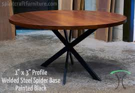 custom made 1 x 3 profile spider table base steel painted black with sapele round
