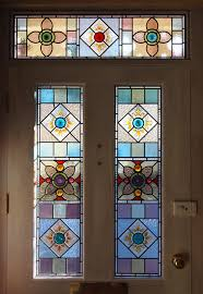 3 stained glass front door panels made using about 80 salvaged glass from some original victorian windows found at the premises in devon