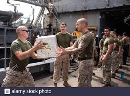 U.S. Marine Corps 1st Lt. Brock Yackey, left, a combat engineer officer  with the 22nd Marine