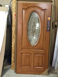 thermatru model cc761c exterior fiberglass door oval glass w satin nickel caming prefinished exterior honey light oak interior blue can be painted