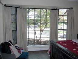 black ceiling mounted rod for window curtains