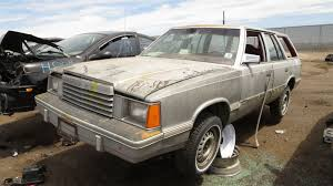 junkyard 1982 dodge aries station wagon 1982 dodge aries wagon in colorado wrecking yard lh front view ©2016 murilee