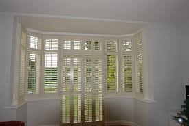 Bay window with French door in the centre #plantationshutters