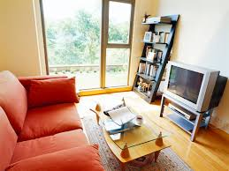 stunning small living room ideas as well as modern furnitures decor with cool orange comfortable fabric sectional sofas and chic red small cushions also