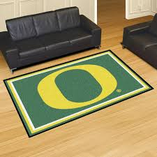 photo 1 of 5 add some color to the room with the oregon ducks 5 x 8 area