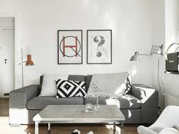 monochrome living room with orange details
