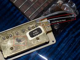 odd wiring in a prs singlecut trem the control cavity looks a right old untidy mess to my eyes the signal cable to the jack has been spliced together the braided wires have been ered to