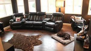 masculine home design with black leather man cave sofa on dark laminate vinyl floor and bear hoax rug vintage chair furniture accessories big brown modern