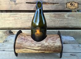 Horseshoe full log wine bottle candle holder. Arizona honey.