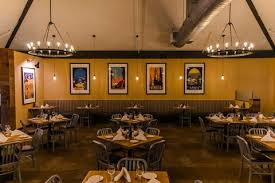 lighting in restaurants. Architect Marites Abueg Imagined Lighting Using Carboy Wine Containers Paired With Leather. Lawrence Worked A Local Leather Artisan To Create In Restaurants