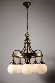 sold splendid antique bronze neoclassical five light chandelier with white globes c 1910