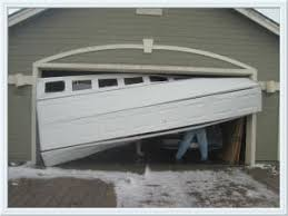 garage door off trackGarage Door Off Track Repair  MGA  2819035152