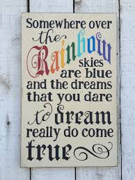 somewhere over the rainbow hand painted distressed rustic wood sign wizard of oz song lyrics children s wall art vintage nursery decor by  on wizard of oz vinyl wall art with somewhere over the rainbow hand painted distressed rustic wood