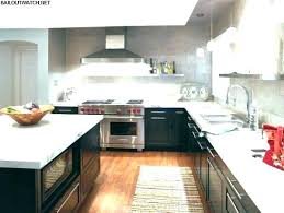 light cabinets with marble countertops dark marble white marble dark kitchen cabinets hardwood floor modern lighting