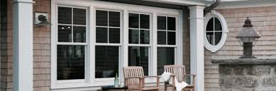 400 series woodwright double hung windows with simulated divided light grilles 2x2 upper sash only in white 400 series oval window in white