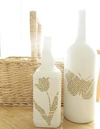 DIY Book page Bottles from The Wicker House A cute way to upcycle old wine  bottles using just spray paint and mod podge.