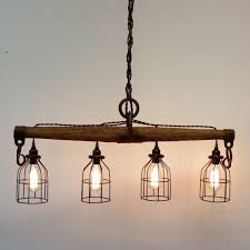 industrial looking lighting. Light Is Interesting. Modern Rustic Chandelier, Featuring Four Lights, Crafted From A Genuine Antique Single Tree Yoke. This Industrial Looking Lighting N