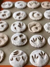 salt dough diy dinosaur fossils on cookie sheet